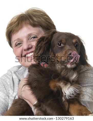 happy senior woman with a dog - stock photo