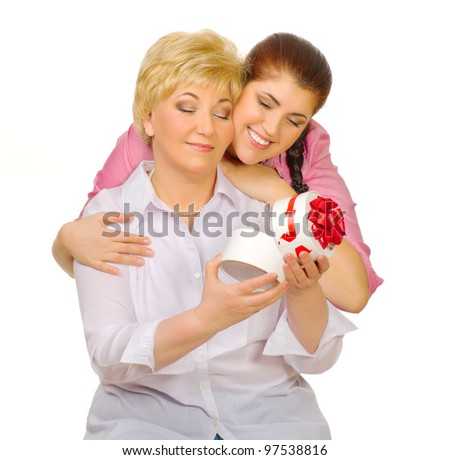 Happy senior woman with her daughter isolated - stock photo