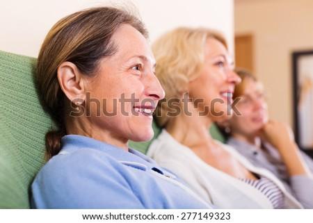 Happy senior women posing at home interior - stock photo