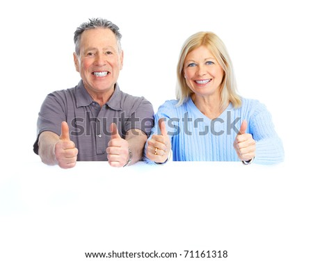 happy seniors couple holding a white placard - stock photo
