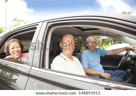happy seniors enjoying road trip and travel - stock photo
