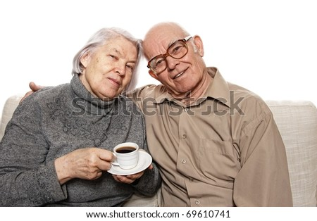 Happy senour couple drinking coffee - stock photo