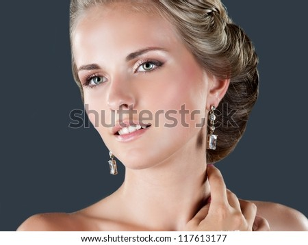 Happy sexy beautiful bride blond girl in white wedding dress with hairstyle and bright makeup - stock photo