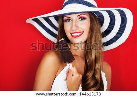 Happy sexy woman holding ice cream - stock photo