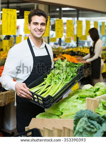 happy  shop people standing near cabbage in grocery - stock photo