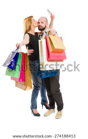 Happy shopping couple using credit card. Consumerism relationship concept on white background - stock photo