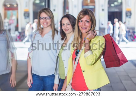 Happy Shopping Female Friends with bags on the street.Group of caucasian women purchasing in the city. - stock photo