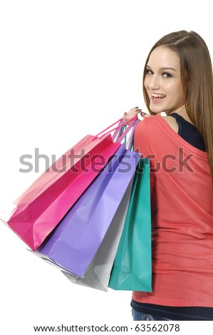 happy shopping girl holding bags - stock photo