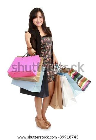 happy shopping girl holding bags in white background - stock photo