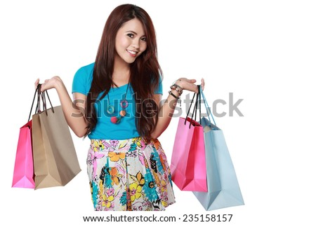 happy shopping girl holding shoping bags in hands. over white background - stock photo