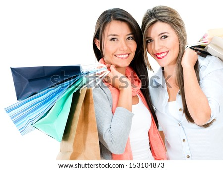 Happy shopping girls holding bags - isolated over white background  - stock photo