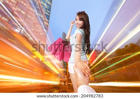 Happy Shopping in hong kong - beautiful young woman holding colored shopping bags at night, asian - stock photo