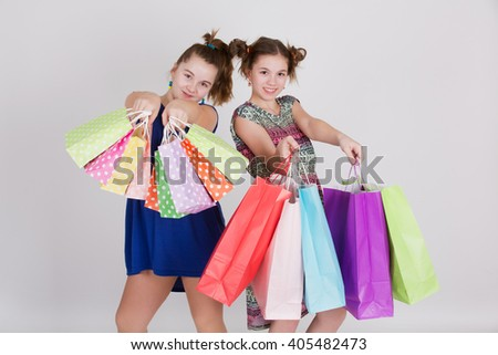 Happy shopping - Two girls with shopping bags - stock photo