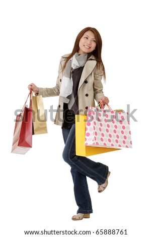 Happy shopping woman holding bags isolated over white. - stock photo