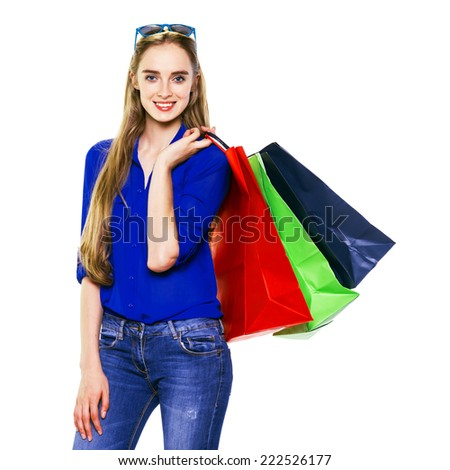 Happy shopping woman holding shopping bags.  - stock photo