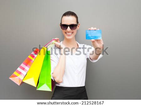 Happy shopping - Woman shopper holding credit card. Shopping, sale concept. - stock photo