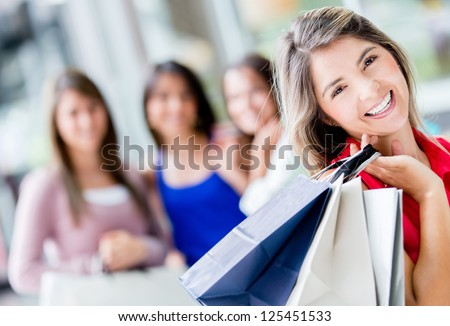 Happy shopping woman with a group of friends - stock photo