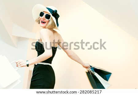 Happy Shopping Woman with shopping bags in motion - stock photo