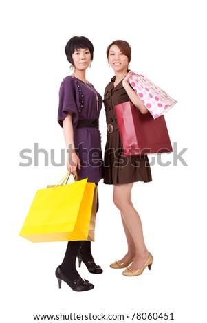 Happy shopping women, full length portrait isolated on white background. - stock photo