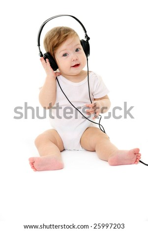 Happy singing baby wearing big black headphones - stock photo