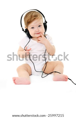 Happy singing baby with black headphones - stock photo