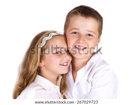 Happy siting and laughing  preschool boy and his sister on white background. - stock photo