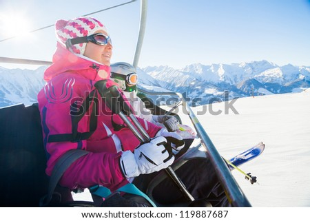 Happy skiers on a ski-lift of Zell am Ziller, Tirol, Austria - stock photo