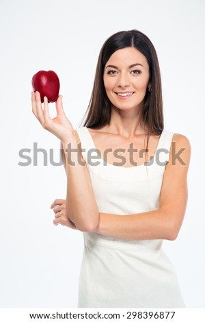 Happy slender woman holding apple isolated on a white background. Looking at camera - stock photo