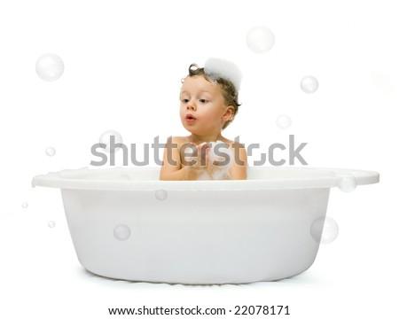 Happy small boy having bath. Isolated over white - stock photo