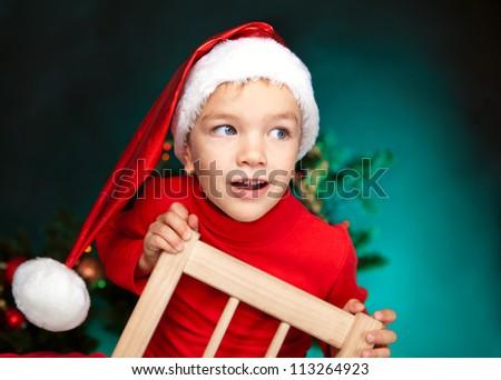 Happy small child in santa hat - stock photo