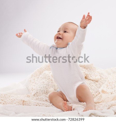 Happy small child looking up surprised. Studio shot. - stock photo
