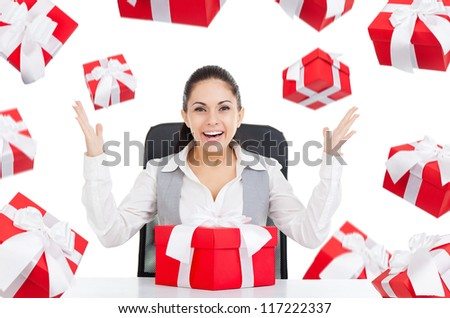 happy smile excited business woman with red gift box sitting at the desk, present fall fly around, isolated over white background, concept of holiday celebrate new year christmas birthday anniversary - stock photo