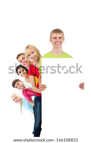 Happy smile group of young people holding a blank white card board, signboard, show empty bill board Isolated over white background - stock photo