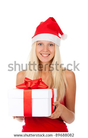 happy smile santa girl hold gift box, woman wear red christmas hat looking at camera, isolated over white background - stock photo