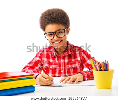 Happy smiling African American teenager, school boy studying, reading a book with eyeglasses. Isolated, over white background, with copy space. - stock photo