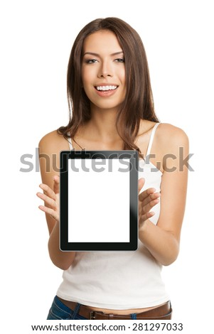 Happy smiling beautiful young brunette woman in tank top casual smart clothing, showing empty blank no-name tablet pc monitor, isolated over white background, with copyspace area for slogan or text - stock photo