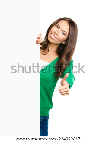 Happy smiling beautiful young woman showing blank signboard or copyspace for slogan or text, with thumb up gesture, isolated over white background - stock photo