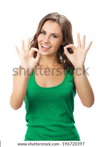 Happy smiling beautiful young woman showing okay gesture in casual smart green clothing, isolated over white background - stock photo