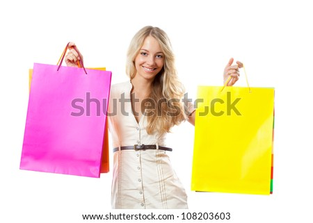 happy smiling blonde woman holding shopping bags over white - stock photo