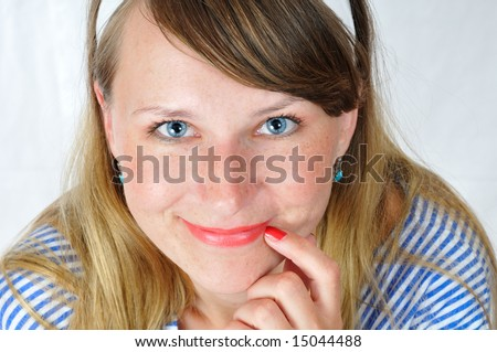 happy smiling blue-eyed girl look at camera - stock photo