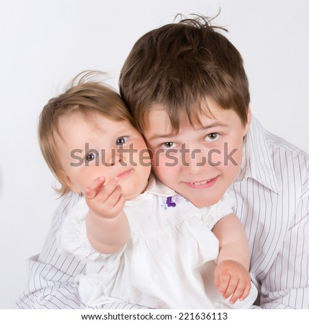 Happy smiling brothers and sisters - stock photo