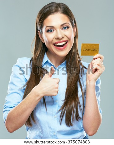 Happy smiling business woman holding credit card show thumb up. isolated studio portrait. - stock photo