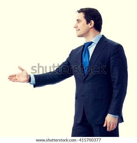 happy smiling businessman giving hand for handshake. Success in business concept. - stock photo