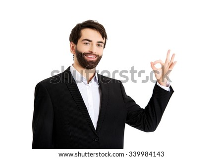 Happy smiling businessman showing perfect sign. - stock photo