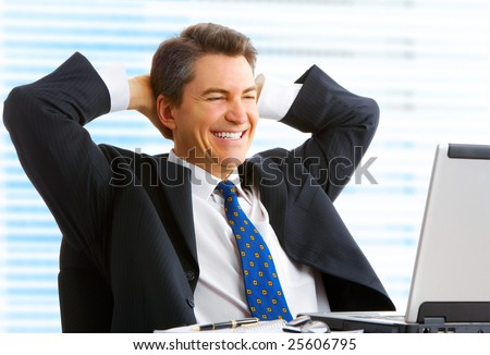 Happy smiling businessman  working with laptop. - stock photo