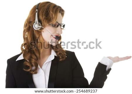 Happy smiling call center woman showing empty palm. - stock photo