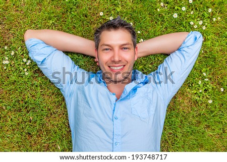 happy smiling carefree man relaxing - stock photo