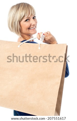 Happy smiling caucasian woman with shopping bags - stock photo