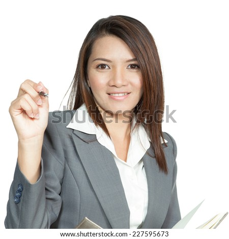 Happy smiling cheerful attractive young business woman writing or drawing on screen with black marker, isolated on white background - stock photo