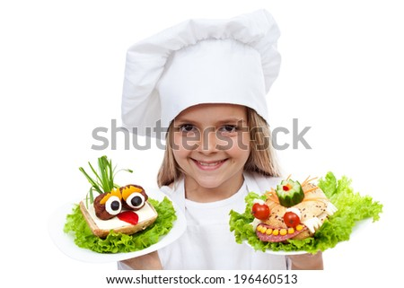 Happy smiling chef kid with creative food - creature sandwiches, isolated - stock photo